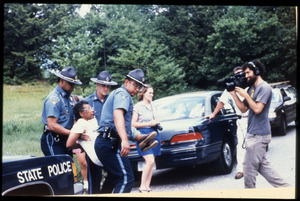 State troopers arresting an unidentified protester, filmed by Robby Leppzer