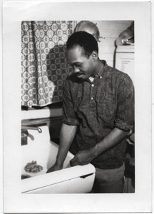 Bob Smith (SNCC worker from Brookhaven, Miss.) washing dishes