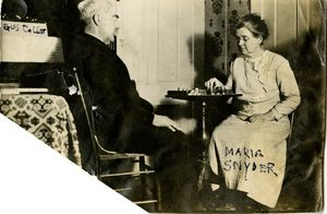 Maria and Harry Snyder playing checkers