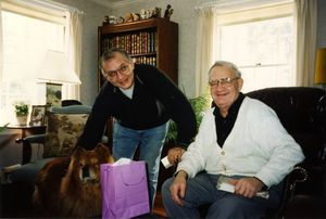 Fred Wilkins and Mirek Szjener with their dog, Toby
