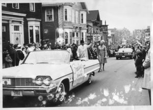 John Joseph Moakley and Evelyn Moakley walking in Saint Patrick's Day parade in South Boston, circa 1960