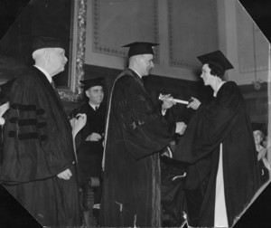 Marian Archer MacDonald (JD 1937), the first woman to graduate from Suffolk University Law School, receives degree from her father, Gleason L. Archer
