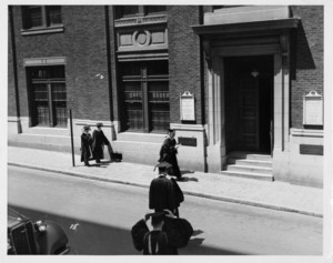 Participants in Suffolk University's first Baccalaureate Exercises walking outside the Archer Building