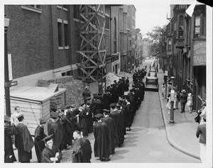 Suffolk University Faculty process down Temple Street for the First Baccalaureate Exercises