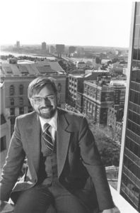 Suffolk University Dean Richard M. McDowell (SOM, 1974-1991), seated with downtown Boston in background