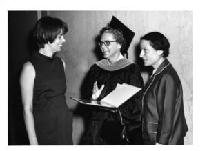 Graduate Patricia I. Brown (center) talks with attendees at the 1970 Suffolk University commencement