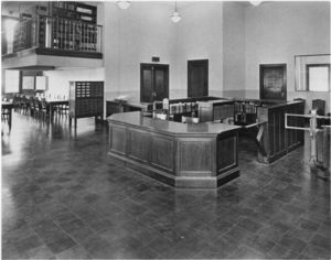 View of the circulation desk, turnstile, and card catalog at the Suffolk University library