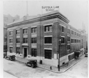 Exterior of Suffolk University's Archer Building (20 Derne Street) that shows Suffolk Law School sign on roof