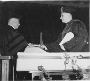 Suffolk University President Gleason L. Archer presenting honorary degree to David Sarnoff, President of RCA, at the 1939 commencement