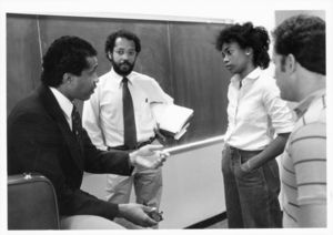Wayne Budd counsels Suffolk University Law students at a CLEO Program event