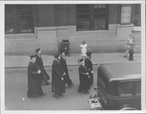 Group of graduates walking at the Suffolk University's first Baccalaureate exercise, 6/13/1937