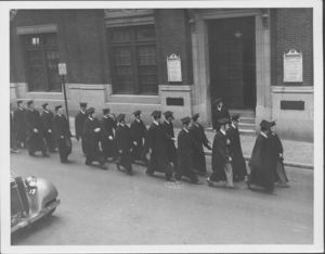Group of graduates walking at the Suffolk University's first Baccalaureate exercises, 6/13/1937