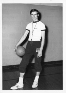 Assistant Basketball Coach James E. Nelson with basketball and whistle
