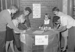 Sign up table for Suffolk University's Glee Club, circa 1965