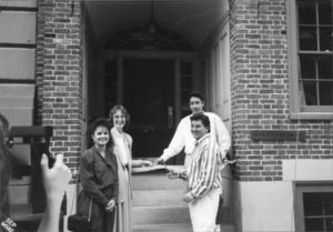 Dean of Students Nancy Stoll and three people at the ribbon cutting ceremony for the new Suffolk University student center (28 Derne Street)