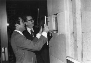 Suffolk University President Daniel H. Perlman (1980-1989) and Trustee Harry Zohn open a time capsule on Founder's day during the university's 75th Anniversary celebrations
