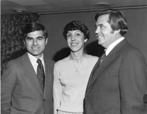 Massachusetts Governor Michael S. Dukakis, Appeals Court Judge Charlotte Perretta, and Suffolk University Law School Dean David J. Sargent at a swearing in ceremony