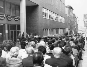 View of attendees at the inauguration of Suffolk University President Thomas A. Fulham (1970-1980) on Temple Street
