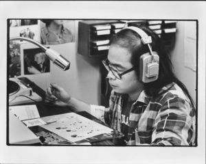 Steve Seto, a student deejay at Suffolk University Radio Station (WSFR), 1975