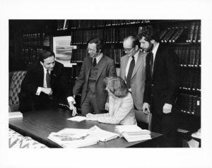 Group of Suffolk University Law Faculty and administrators in the faculty library