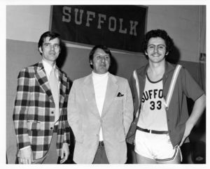 Suffolk University men's basketball player Chris Tsiotos (right) with Coach James Nelson (left) and team captain Don Woodrow ) at game versus Connecticut College, circa 1978-1979