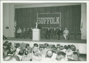 Guest speaker behind podium at an event in Suffolk University's C. Walsh Theatre (55 Temple Street)