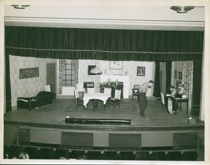 Actors on the stage during a production of a play at Suffolk University's C. Walsh Theatre (55 Temple Street)