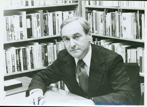 Suffolk University Professor Stanley M. Vogel (CAS) - Department Chair - English, seated with bookshelf in background