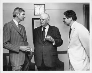 Vice President and Treasurer Francis X. Flannery (left) with Dean Donald R. Simpson (Law) and Vice President Donald Grunewald (right) at a Suffolk University event