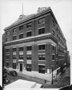 Exterior of Suffolk University's Archer Building (20 Derne Street), showing the electric sign on the roof