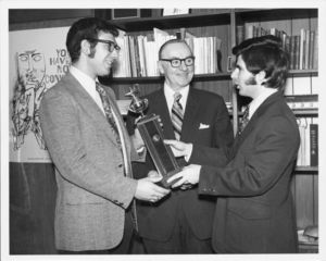Suffolk University President Thomas A. Fulham (1970-1980) congratulates the winners of the 1973 Jessup Moot Court competition regionals, Allen Shirlman and Kenneth Sherman