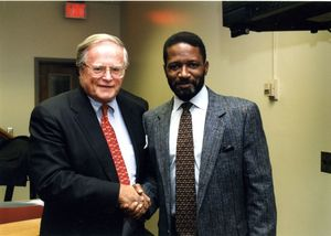 Suffolk University Dean John E. Fenton, Jr. (Law) shaking hand of unidentified man