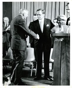 Suffolk University Dean John E. Fenton, Jr. shaking President John E. Fenton's (his father) hand at a campus event
