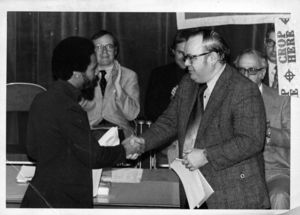 Suffolk University Dean Michael Ronayne (CAS) presents an award to a student at the 1976 Recognition Day ceremony