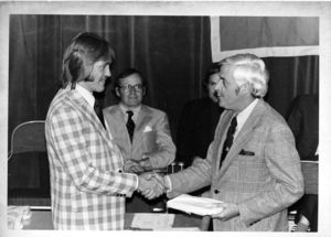Suffolk University Dean of Students D. Bradley Sulllivan presents an award to a student at the 1976 Recognition Day ceremony