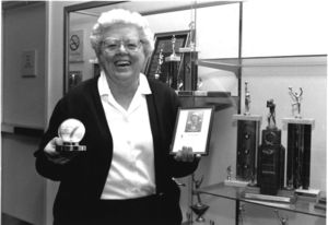 Suffolk University Law School Librarian and alumnus Patricia I. Brown donating items related to her career in the All-American Girl's Professional Baseball League to the university