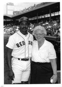 Suffolk University's Patricia I. Brown poses with Red Sox player Tony Pena