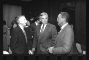 Suffolk University Trustee Lawrence Cameron and other attendees at an event honoring President Daniel H. Perlman (1980-1989)