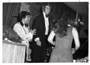 Three Suffolk University students in formal attire at a banquet, 1972