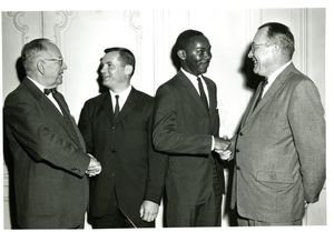 Dean Frederick McDermott (Law) and President Dennis C. Haley (1960-1965) and others at Suffolk University's Law Day, 1962