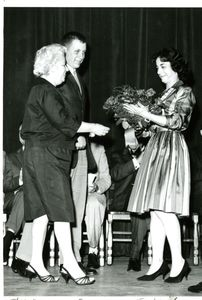 "Dorothy ""Dottie Mac"" MacNamara receiving flowers at a Suffolk University award ceremony"