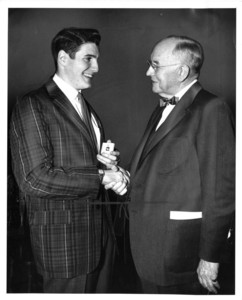 Suffolk University student Alan Chapman and President Dennis C. Haley (1960-1965) at the 1961 Recognition Day