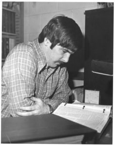 Larry Boyle, executive editor of Suffolk Law Review pores over case in the Law Review offices, circa 1970s