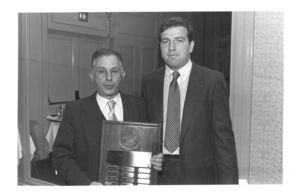 Edward Seksa, editor-in-chief of 1983-1984 Law Review, presents the Suffolk University Law School Review recognition award to Law Library Director Edward J. Bander