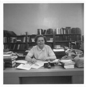 Suffolk University Law Librarian Patricia I. Brown sitting at desk