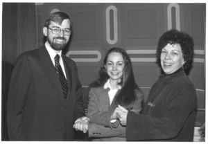 Francis X. Flannery, Janette Fasano, and Professor Frances Burke (CAS) shake hands at President Carter's Management Intern Program event at Suffolk University