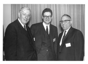 Dean Donald Goodrich (CAS), Peter Volpe and another man at a Suffolk University Advisory Council meeting