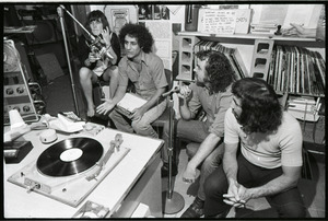 Abbie Hoffman: unidentified woman, Hoffman, George Kimball, and Bruce McCabe(?) in WBCN studio (left to right)
