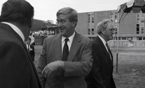 Ceremonial groundbreaking for the Conte Center: unidentified man chatting with Gov. William Weld, Richard O'Brien in background