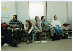 Organic Farmers Associations Council meeting: people seated around the edge of a room